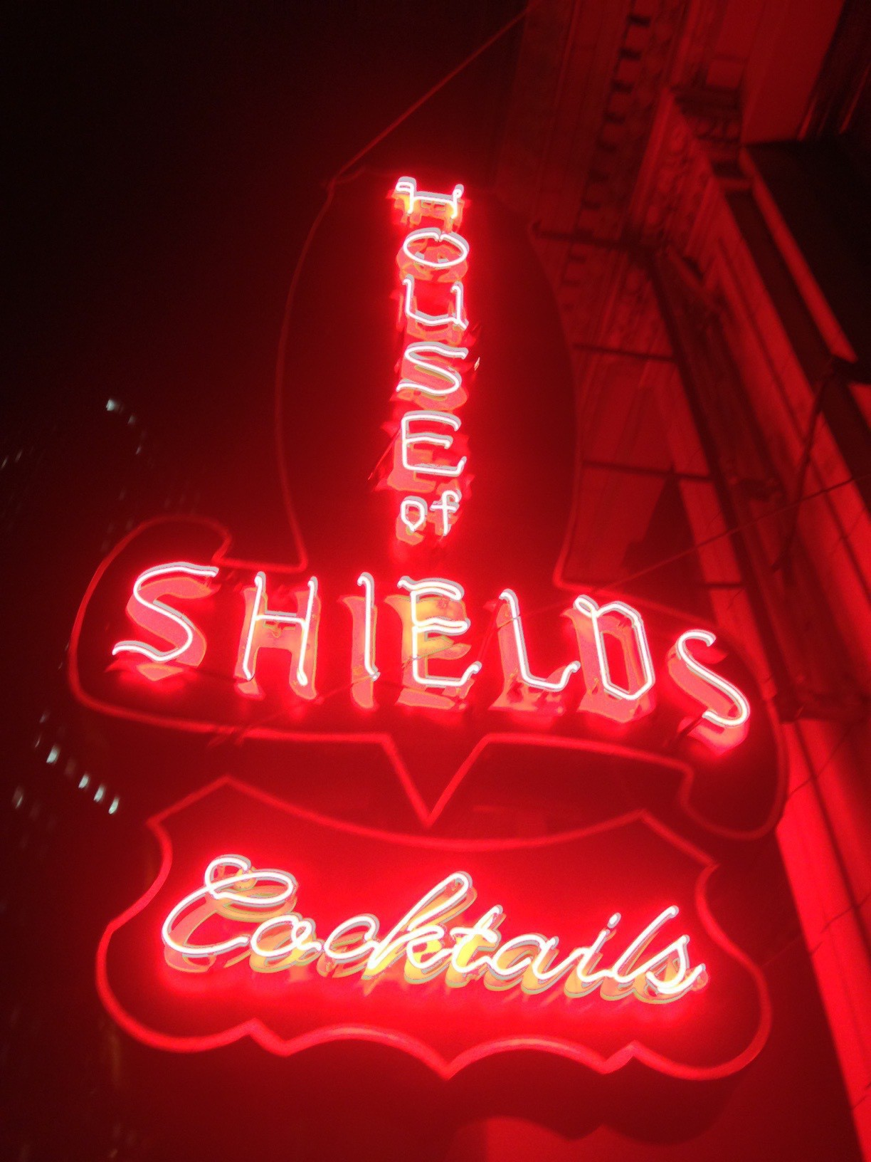 The neon sign out front of the House of Shields